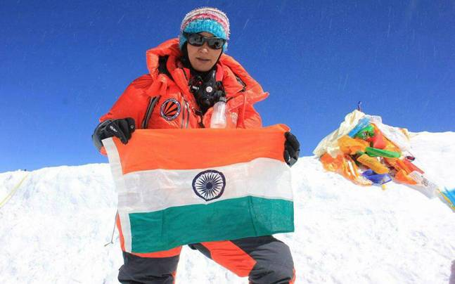 Anshu Jamsenpa at the top of Mt. Everest